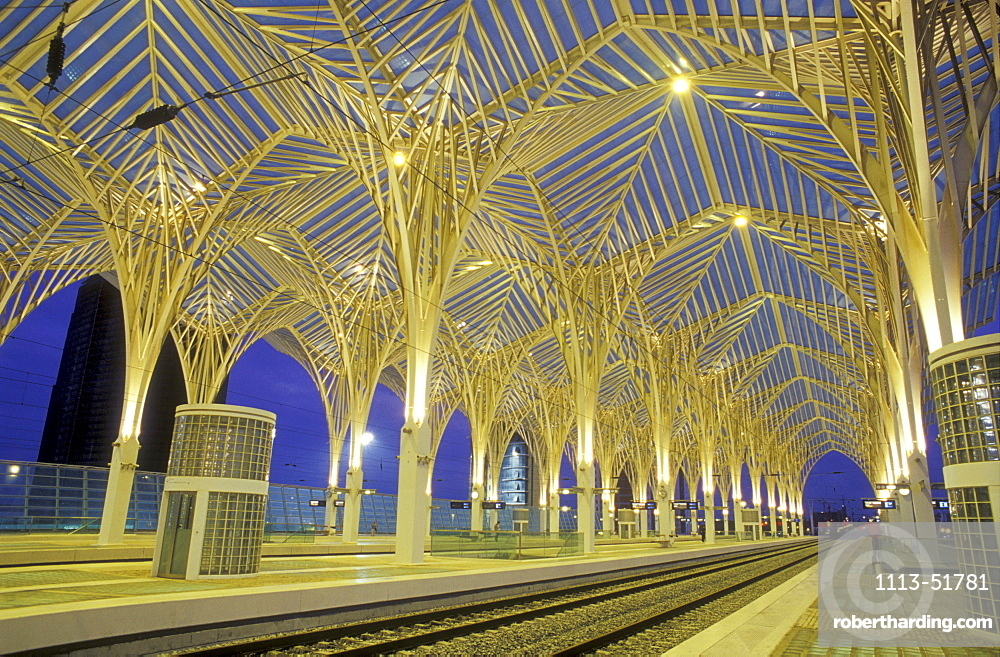 Illuminated, deserted railway station in the evening, Gare do Oriente, Parc de Nacoes, Lisbon, Portugal