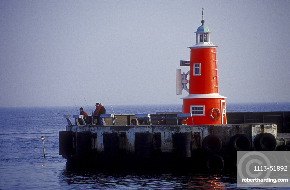 Anglers and lighthouse at harbour of Helsingor, Zealand, Denmark, Europe