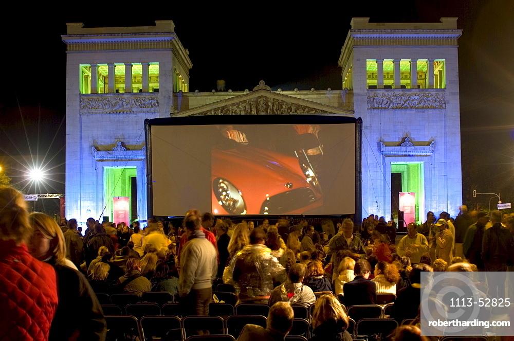 Spectators in front of the silver screen of an open air cinema, Koenigsplatz, Munich, Bavaria, Germany, Europe