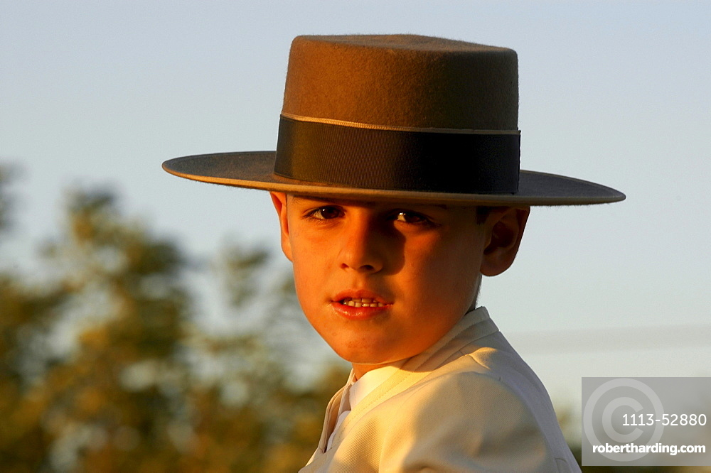 Boy with traditional hat, Romeria, Seville, Andalucia, Spain