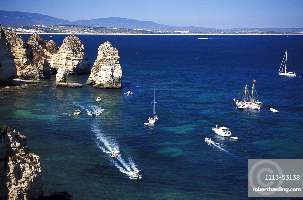 High angle view of boats and rocky coast, Ponta da Piedade, Lagos, Algarve, Portugal, Europe