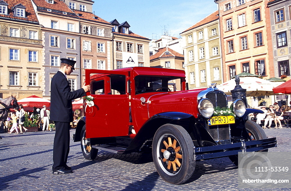 Red oltimer at old market square, Warsaw, Poland, Europe