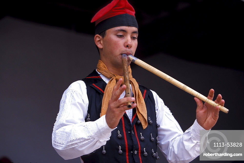 Man wearing traditional clothes, playing the flute, Folklore, Sant Miquel, Ibiza, Balearic Islands, Spain