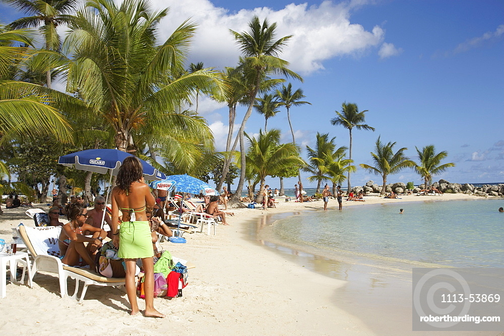 Girl selling clothes on Sainte-Anne Beach, Grande-Terre, Guadeloupe, Caribbean Sea, America