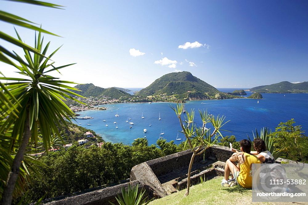 Panoramic view, Couple admiring the view, Fort Napoleon, Terre-de-Haute, Les Saintes Islands, Guadeloupe, Caribbean Sea, America
