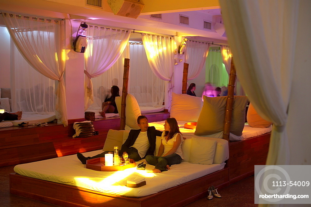 People sitting on a bed in a theme restaurant BED, South Beach, Miami, Florida, USA, America