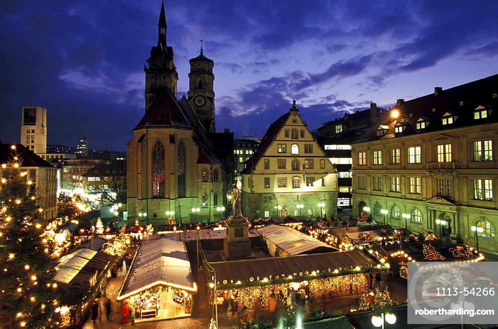 Christmas market on the Square Karlsplatz with church Stiftskirche and Schiller monument, Stuttgart, Germany