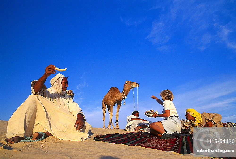 Picnic in the desert with Ben Ali, Dune landscape near Nefta, Tunesia