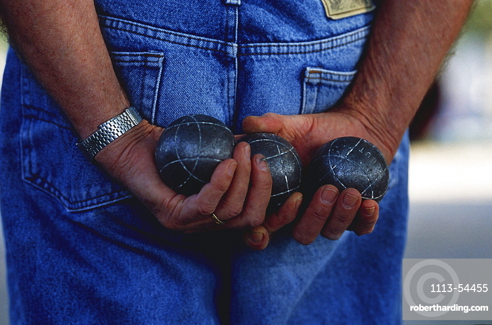 Man with bowls in his hands, Arles, Bouches-du-Rhone, Provence, France, Europe