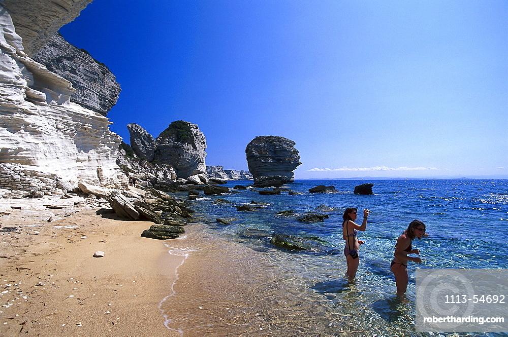Two women at the beach, Plage de Sutta Rocca, cliffs of Bonifacio, Corsica, France