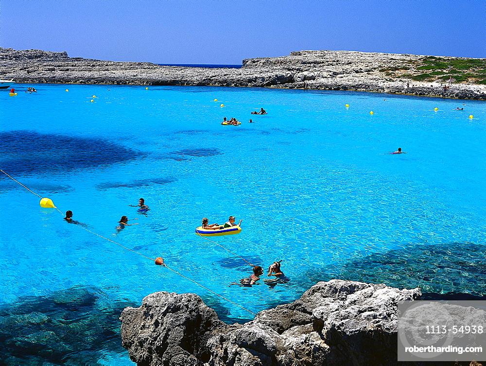 People swimming in the sea, Cala Binibeca, Minorca Spain