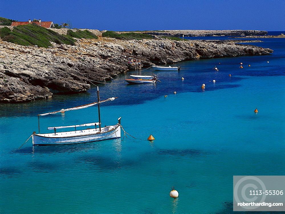 Boat in a bay, Cala de BinisafË™ller, Minorca, Balearic Islands, Spain