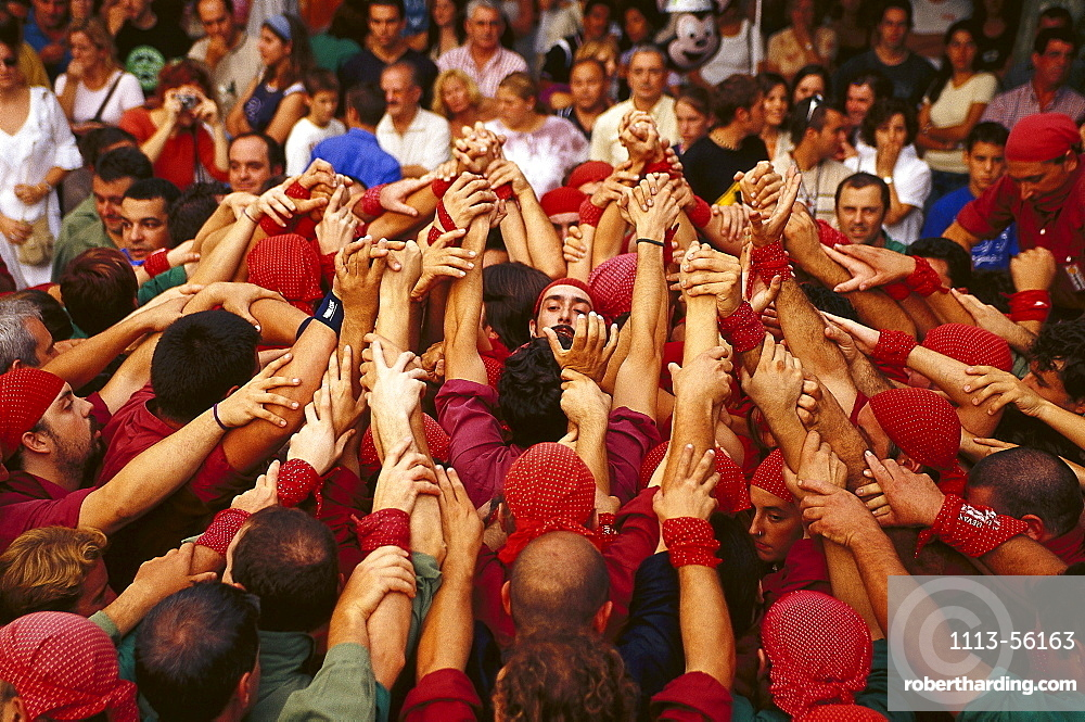 Castellers forming the base of a castell, human tower, during the Wine Festival, Benissalem, Mallorca, Majorca, Balearic Islands, Spain