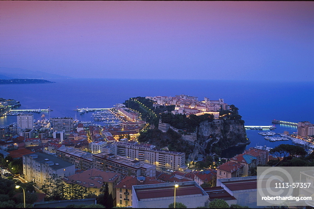 The town of Monaco and castle at dusk, Monaco, Cote d'Azur, France, Europe