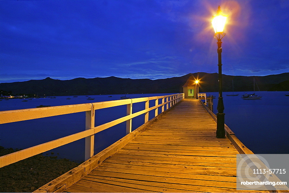 Jetty with lantern at harbour in the evening, Banks Peninsula, Akaroa, New Zealand, Oceania