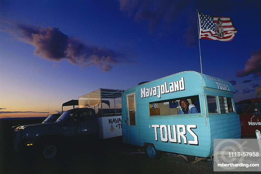 Caravan in the evening light promoting tours, Travel guide, Monument Valley, Arizona, USA