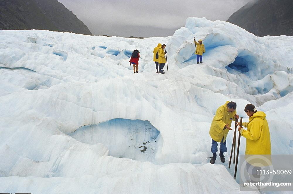 Tourists on Fox Glacier, Westland National Park, South Alps, South Island, New Zealand, Oceania