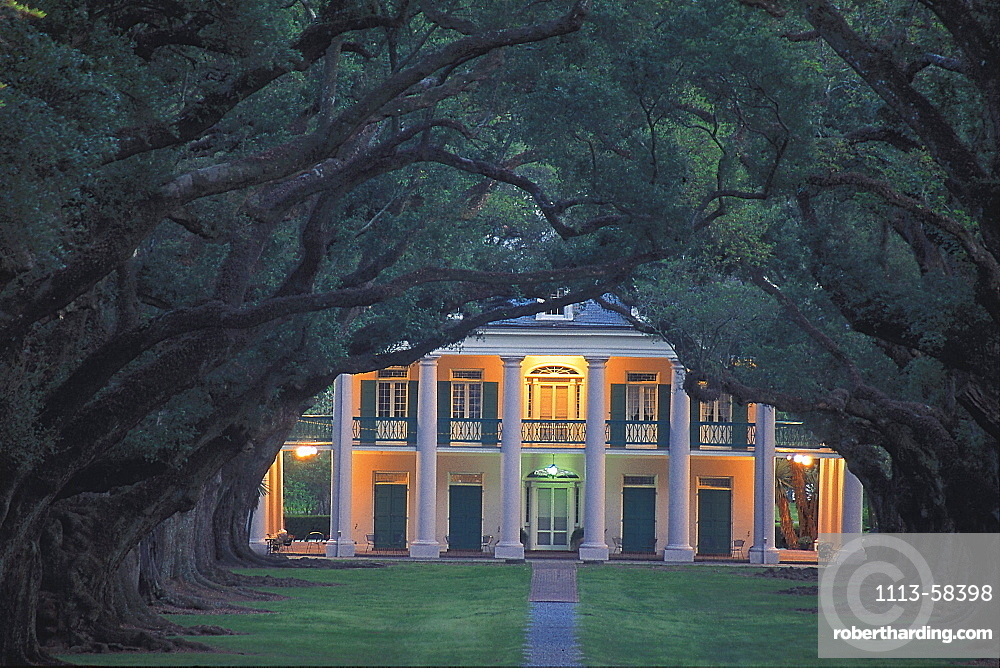 View through an oak alley at a house at dusk, Oak Alley Plantation, Lousiana USA, America