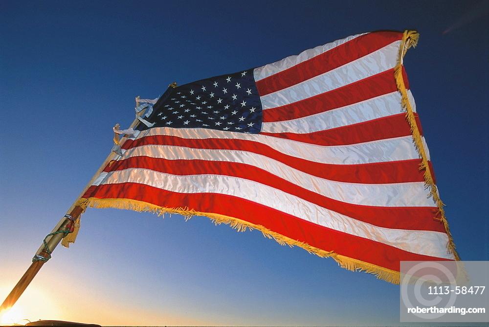 American Flag, Stars and Stripes against a blue sky, USA