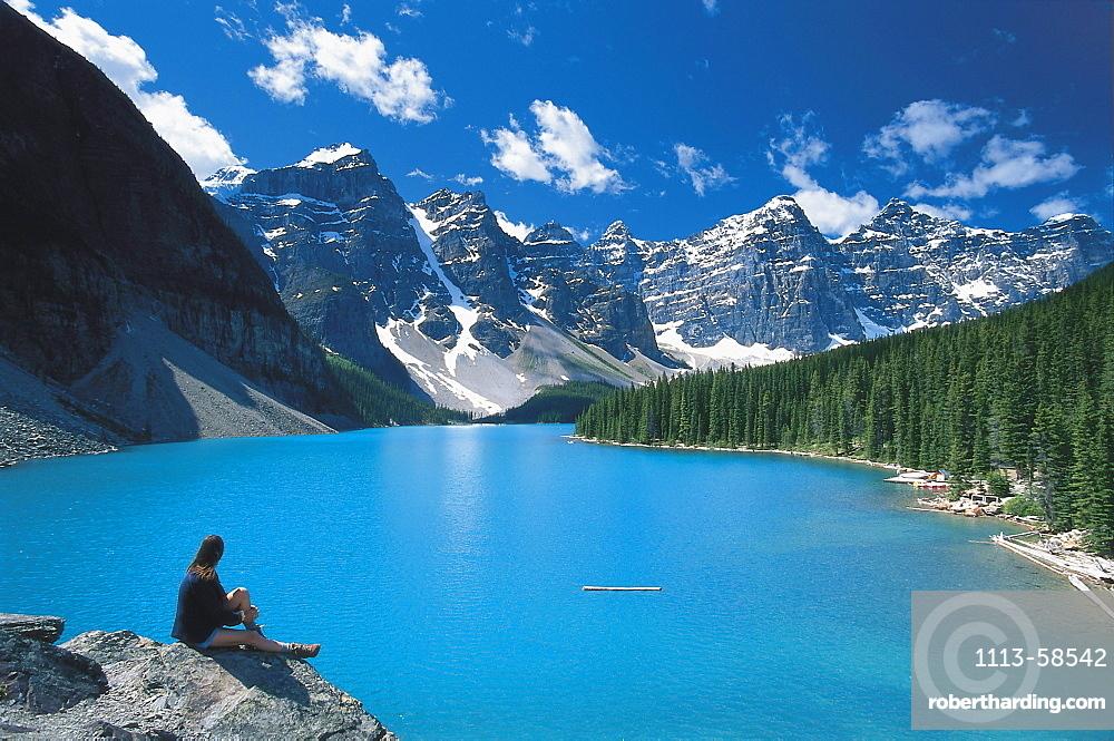 Woman enjoying the viewa at Moraine Lake, Ten Summits, Rocky Mountains, Alberta, Canada