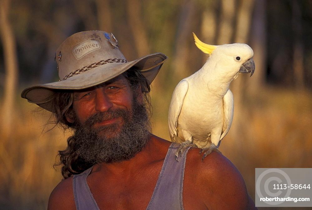 Bushman with cockatoo, Austrailian Bush, Australia
