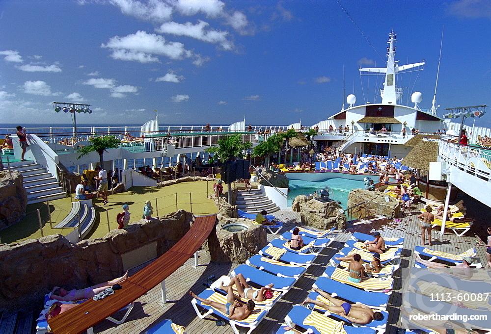People on the sun deck, cruise ship AIDA, Caribbean, America