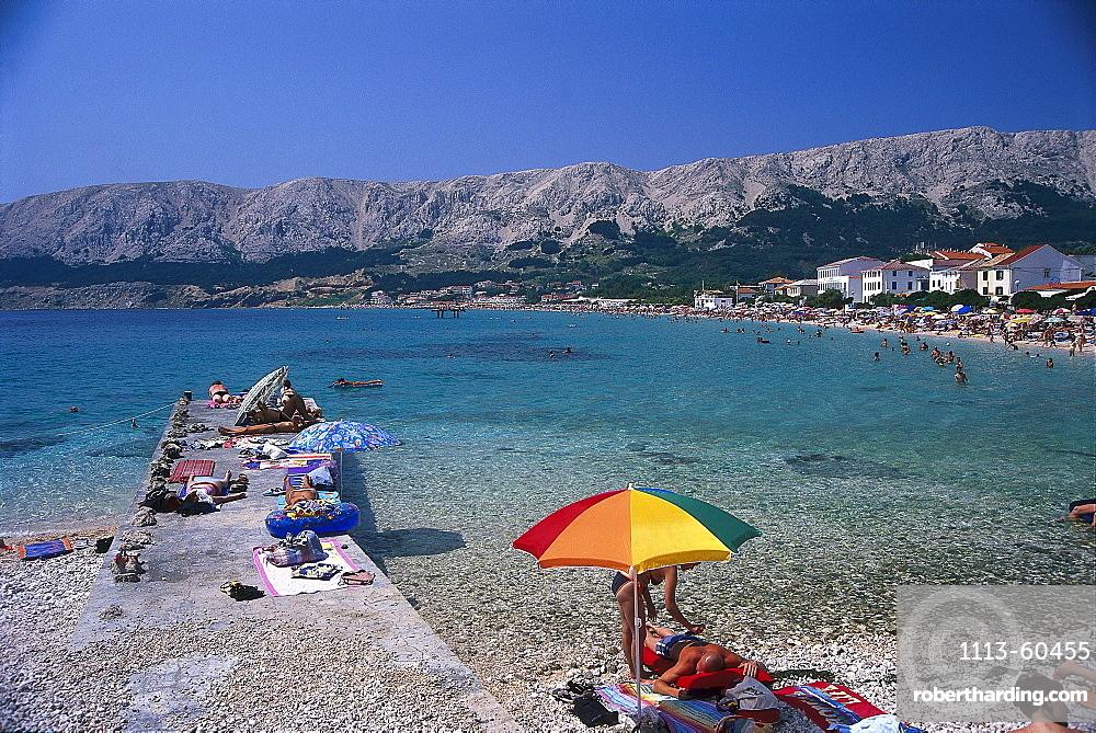 People on the beach in the sunlight, Baska, Krk, Croatia, Europe