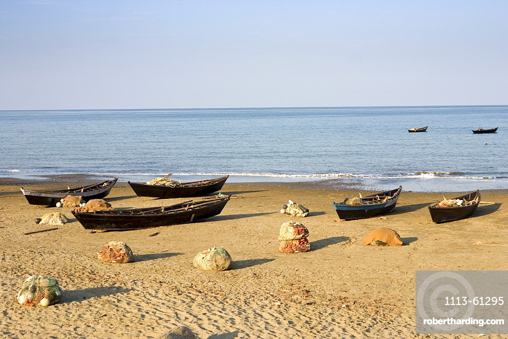 Fishing boats on the beach of Cuthbert Bay, Long island, Andamanen, Indien
