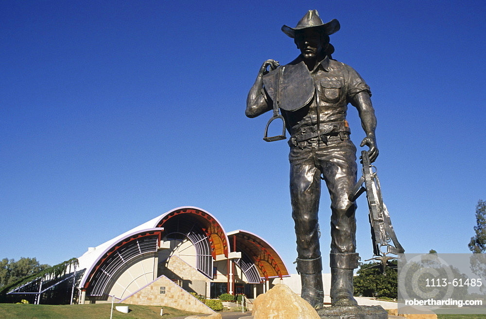 Statue of a stockman outside the Australian Stockman's Hall of Fame museum, museum dedicated to the history of the outback settlers such as explorers, sheep shearers stockmen, Longreach, Queensland, Australia