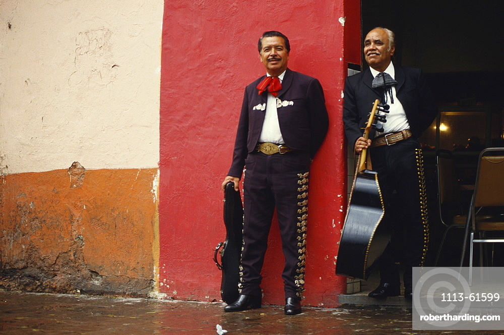 Two Mariachi musicians with their instruments, Mexico. Central America