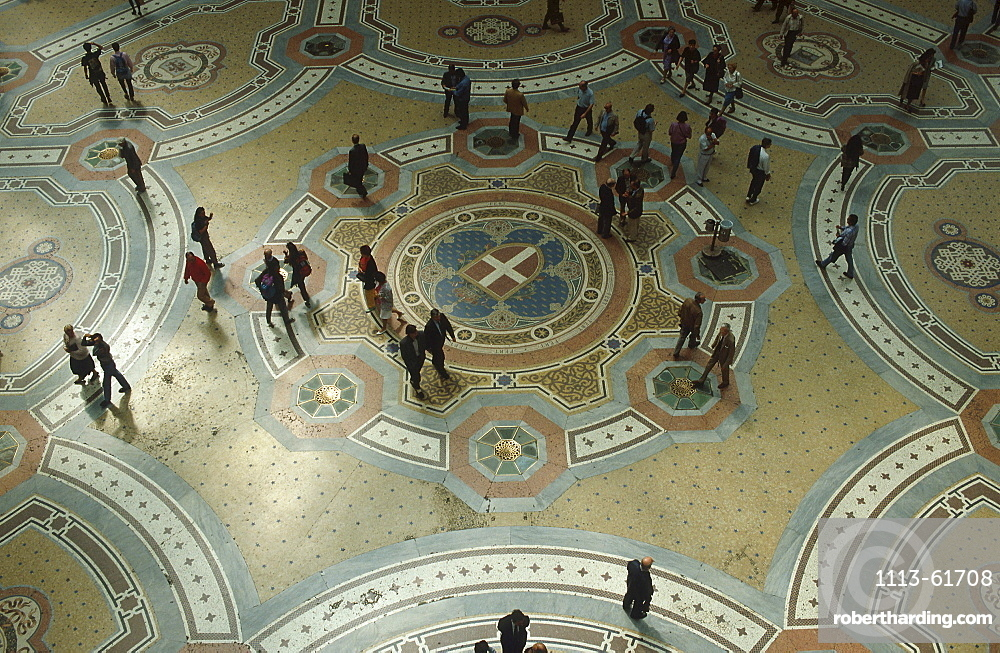 People in Galleria Vittorio Emanuele II, floor mosaic, Milan, Italy
