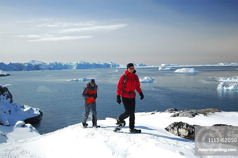 A couple snowshoeing, Ilulissat, Greenland