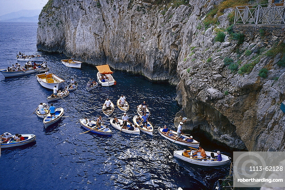 View at people on boats outside the blue grotto, Capri, Italy, Europe
