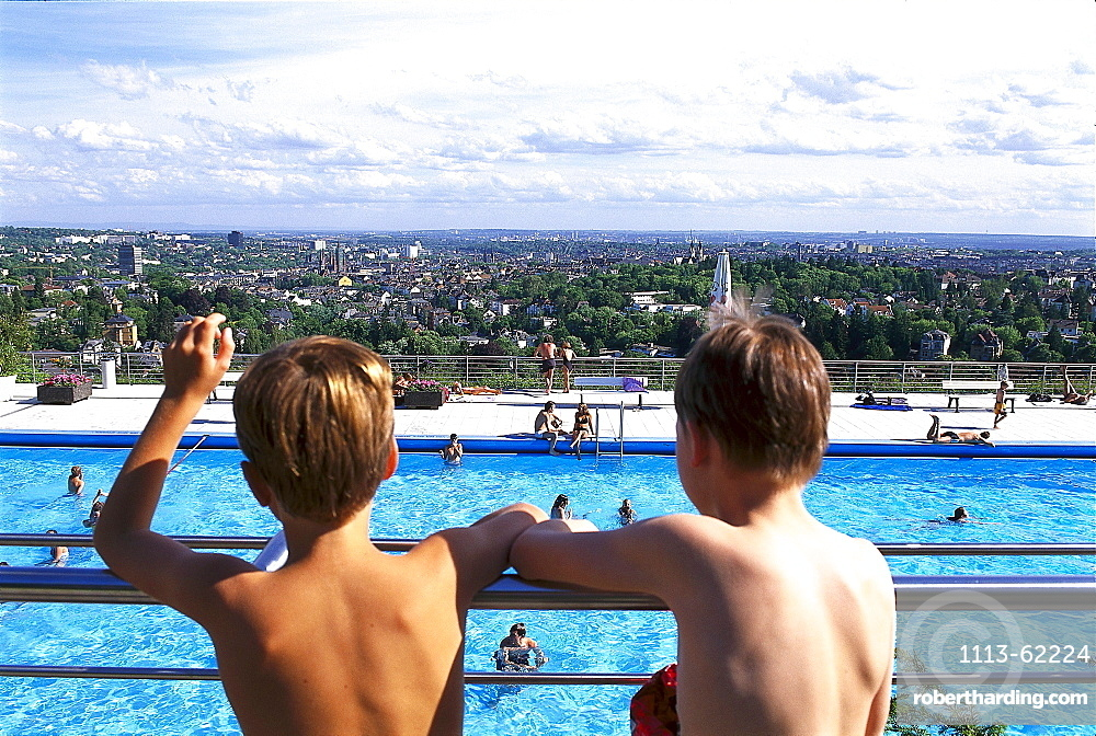 Two boys at open air pool Opelbad, Neroberg, view over Wiesbaden, Hesse, Germany, Europe