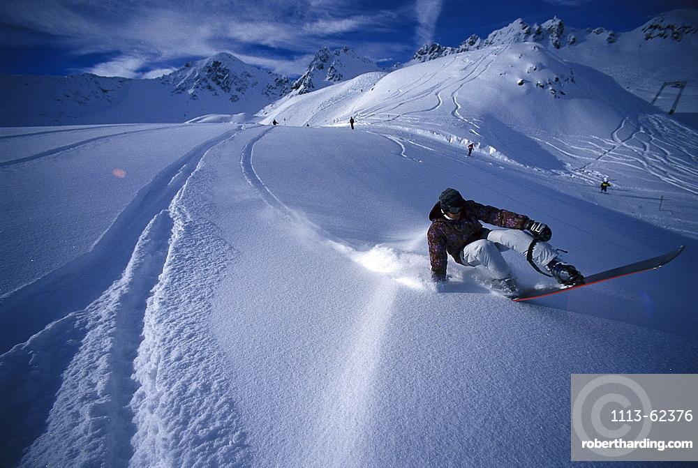 Snowboarder at descent, Kauner valley, Tyrol, Austria, Europe