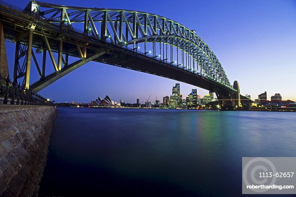 View below the Sydney Harbour Bridge across the harbour to the Opera House, Sydney, Australia