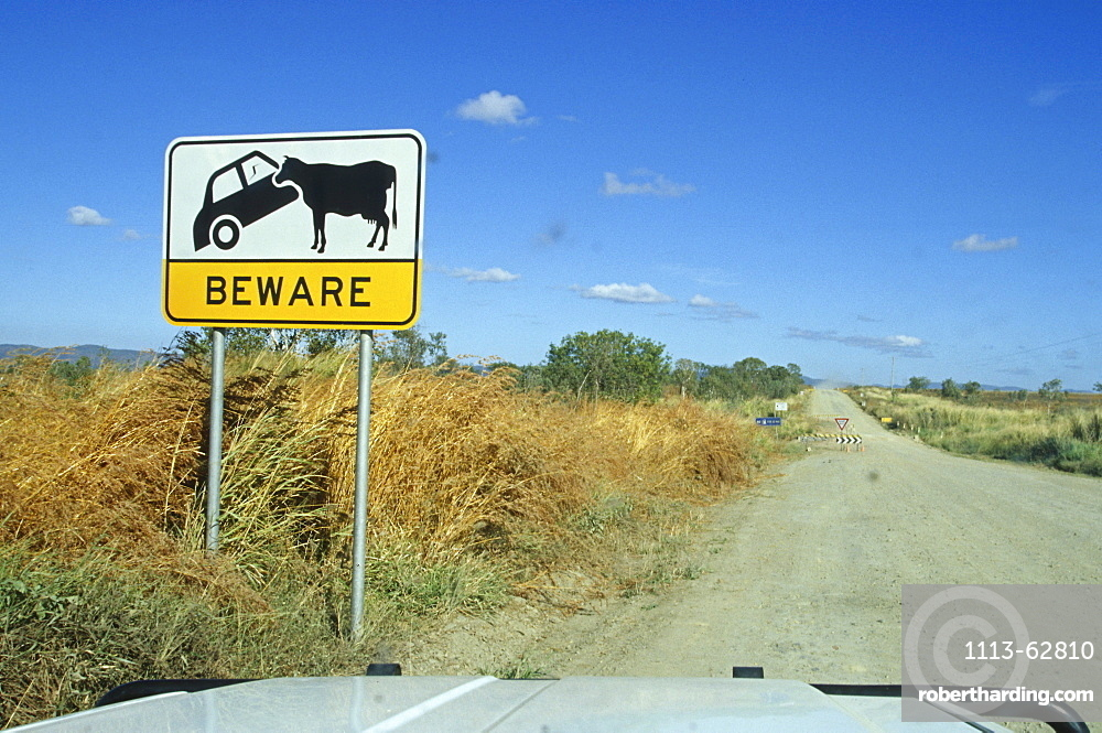 Outback sign warning cattle might be on the road, dirt road, Australia