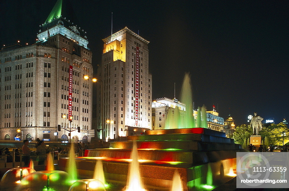 fountain in front of Peace Hotel, the Bund at night, Shanghai, China