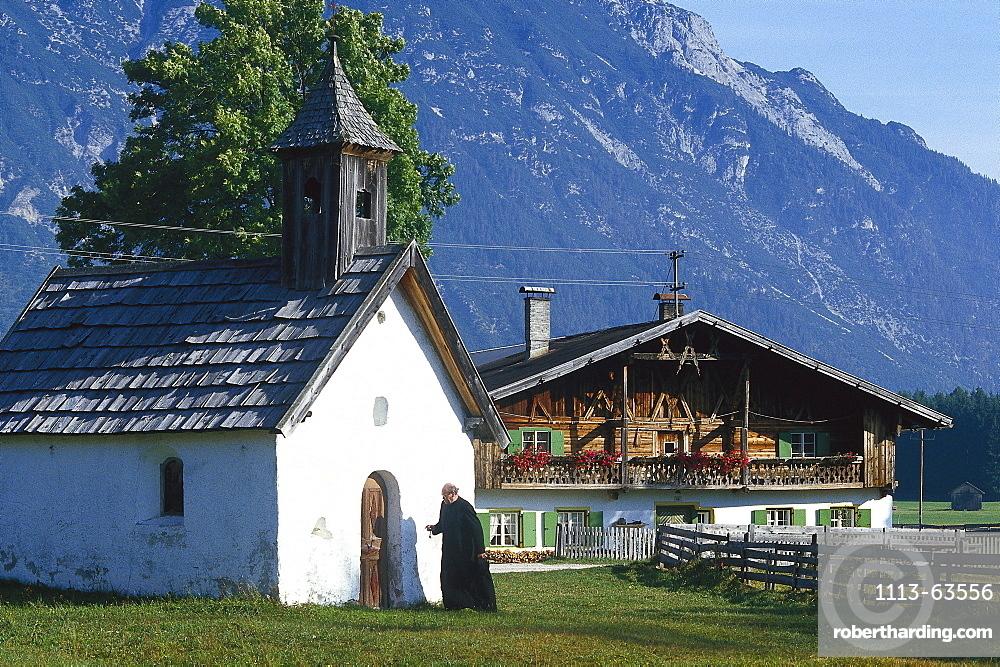 Priest locking his chapel, Tyrol, Austria