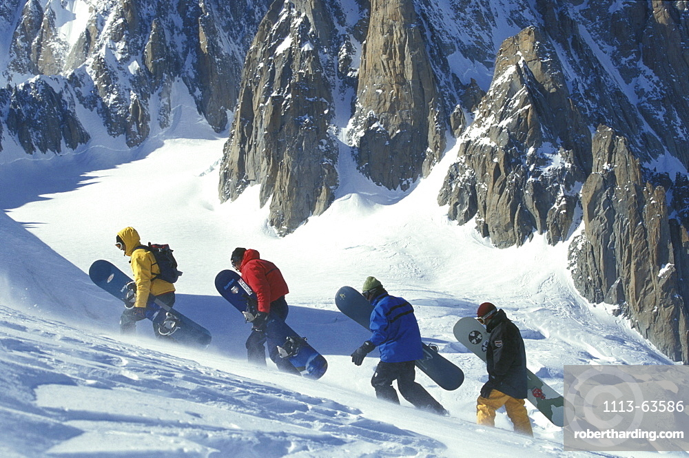 Snowboarder ascending, high mountains, Italy