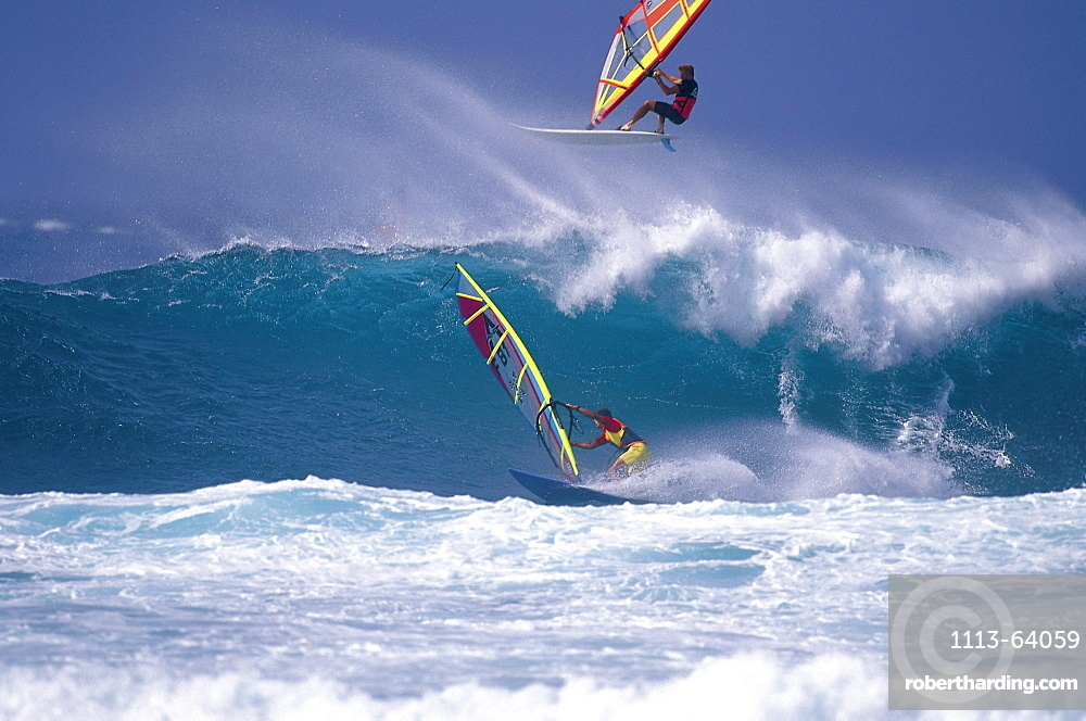 Two sailboarders in front of a wave, France, Europe