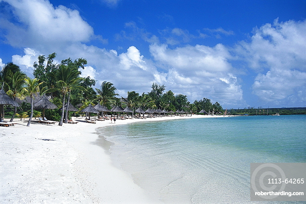 Sandy beach with palm trees in the sunlight, Hotel Le Prince Meurice, Mauritius, Africa