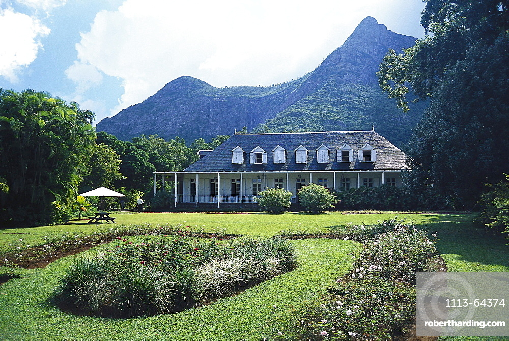 Historical colonial style house and garden in front of a mountain, Eureka, Mauritius, Africa