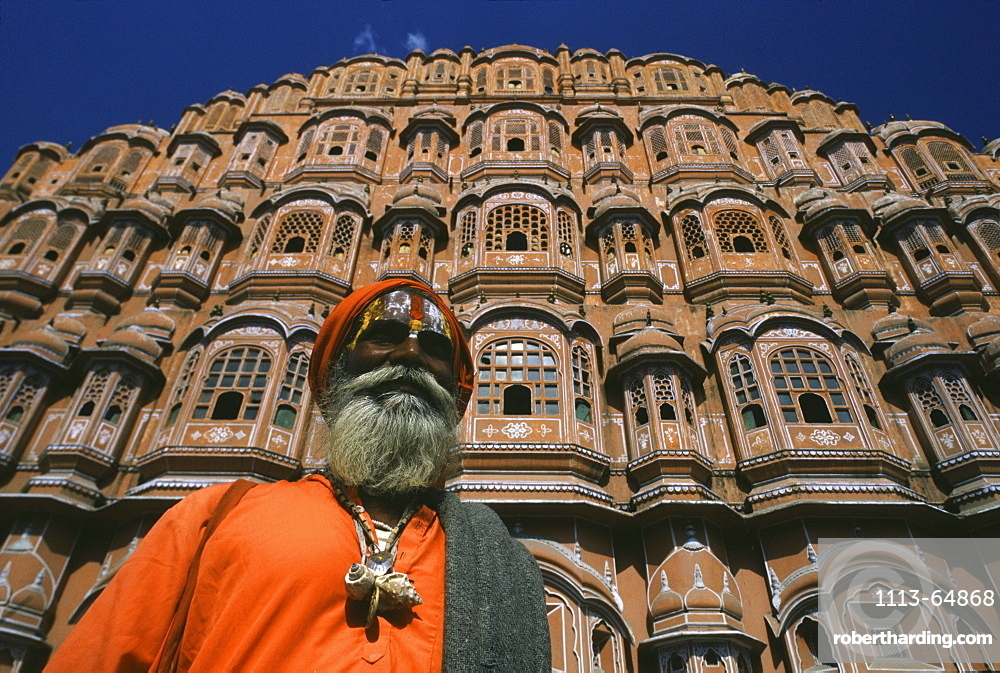 Old man in front of the Palace of the Winds in the sunlight, Jaipur, Rajasthan, India, Asia