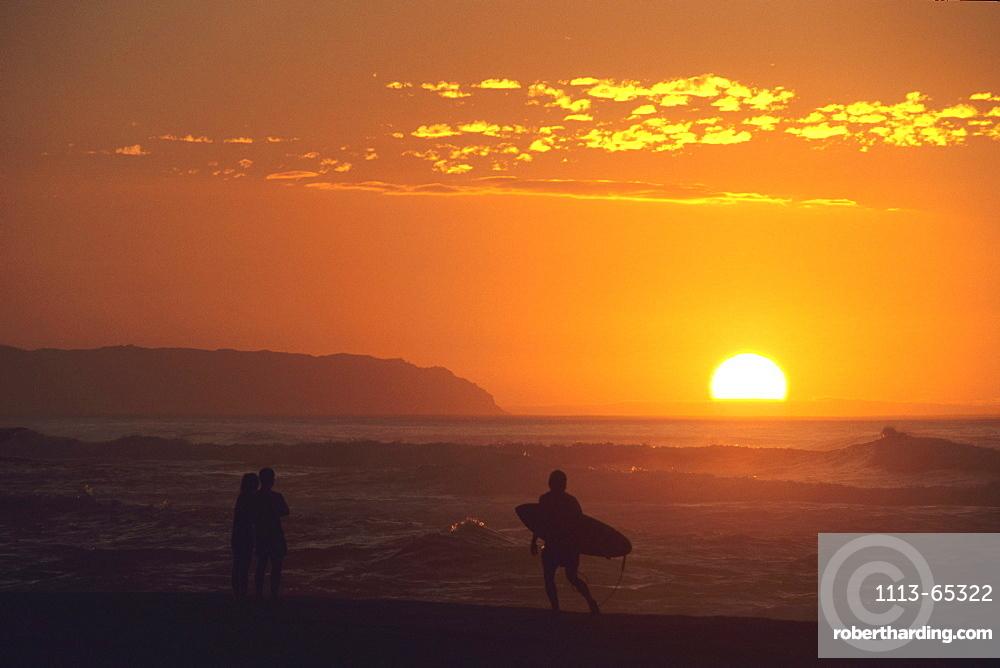 Couple & Surfer at Sunset, Barking Sands Beach, Polihale State Park, Kauai, Hawaii, USA