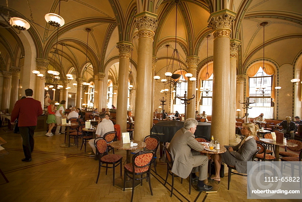 People sitting inside at Cafe Central, Vienna, Austria