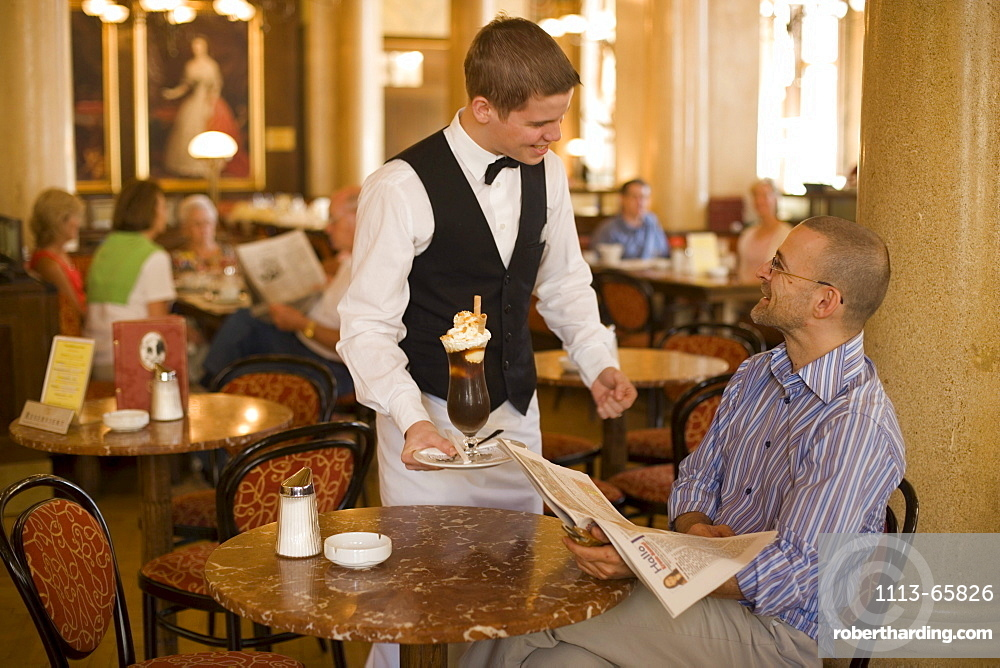 Waiter serving coffee ice, Cafe Central, Waiter serving coffee ice to a guest of Cafe Central, Vienna, Austria