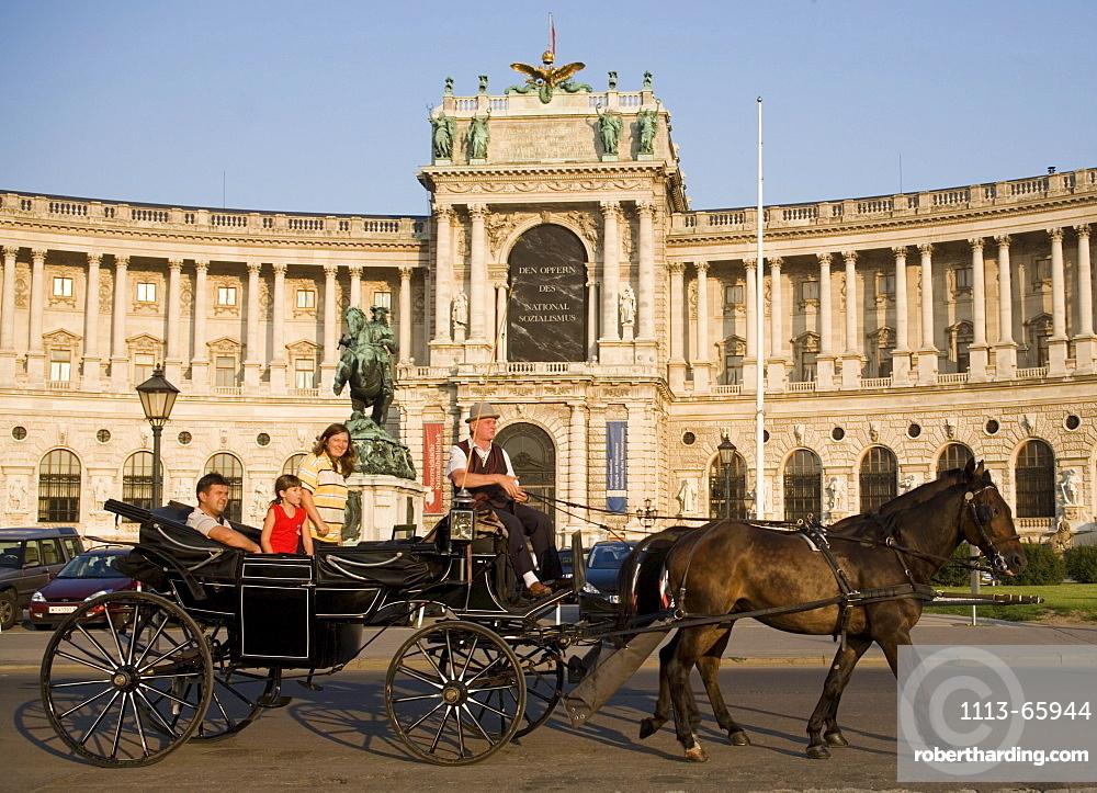 Fiaker passing the Neue Hofburg during a city tour, Vienna, Austria