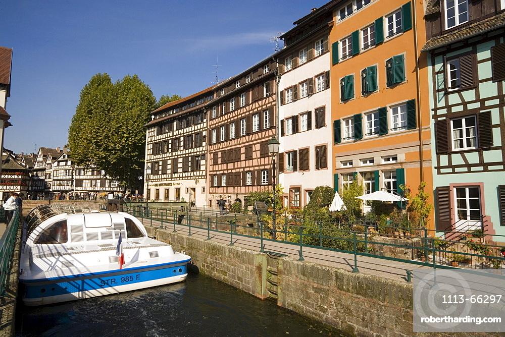 Excursion boat passing the district La Petit France, Excursion boat passing a lock in the district La Petit France Little France, Strasbourg, Alsace, France