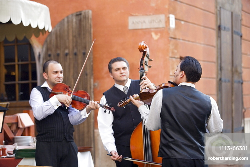 Musicians in front of a restaurant, Musicians in front of a restaurant on Castle Hill, Buda, Budapest, Hungary